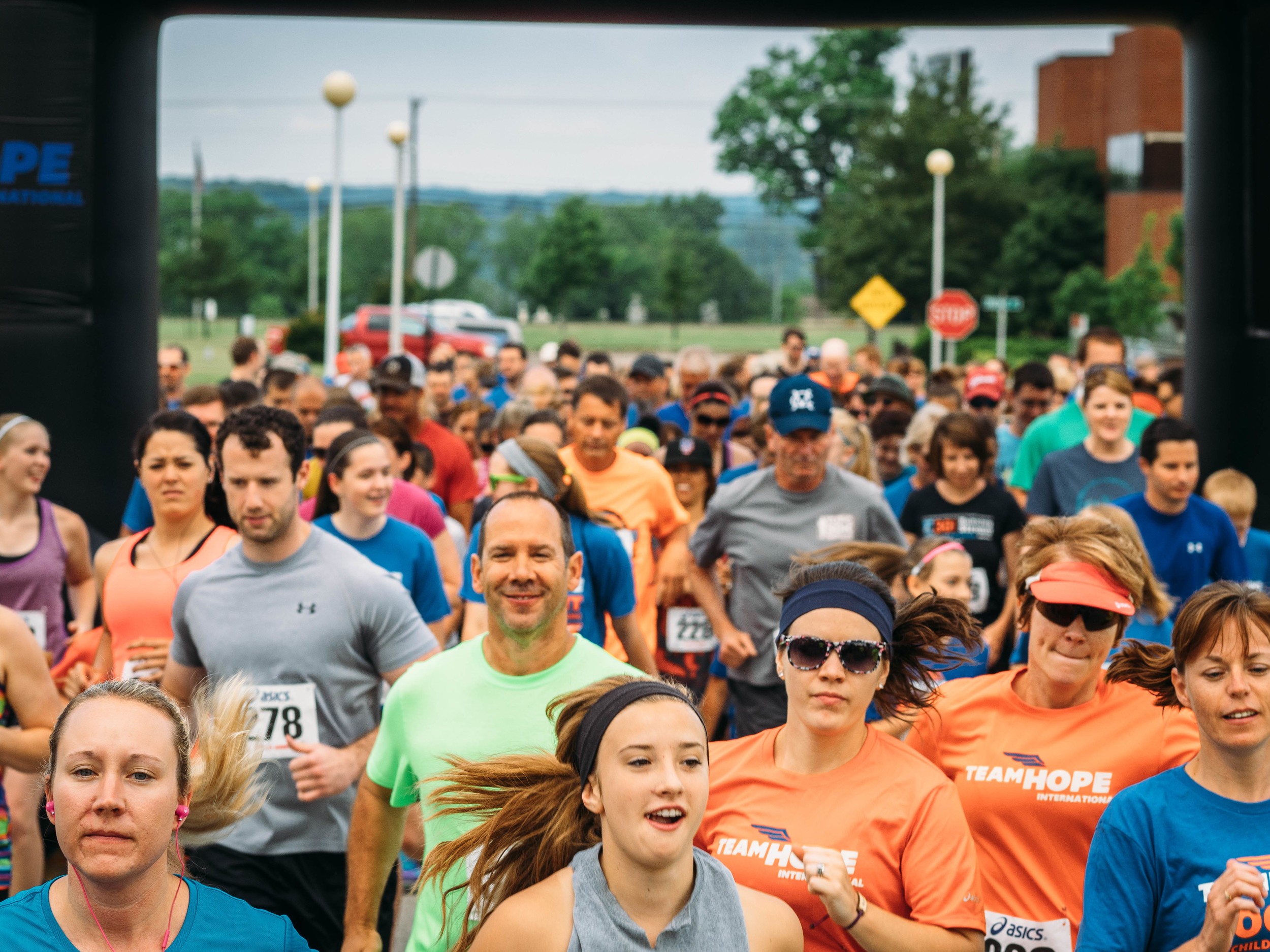"""Runners of all ages and experience levels gathered to raise funds for orphaned kids at the first ever Team Hope""""Sock It To Child Trafficking 5k"""" in Wooster, Ohio."""
