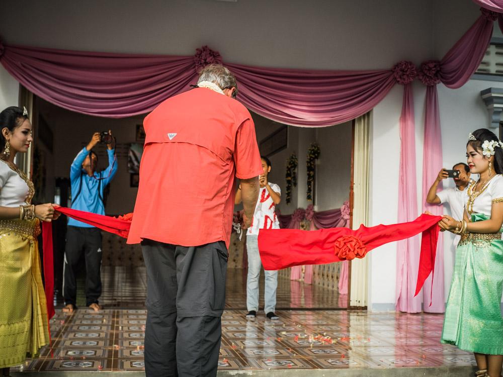 Wes Polsdorfer cuts the ribbon at the Battambang 13 Children's Home