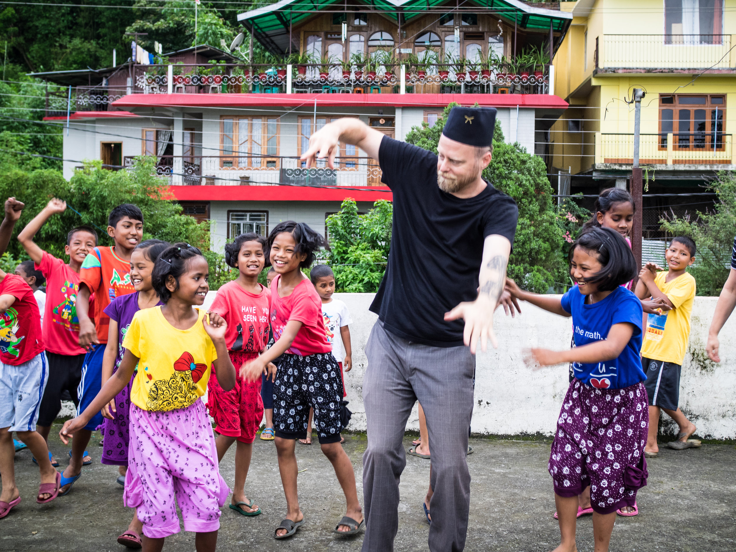 Executive Director John McCollum dancing with the kids at the Kalimpong 2 Children's Home in the foothills of India's Himalayan mountains.