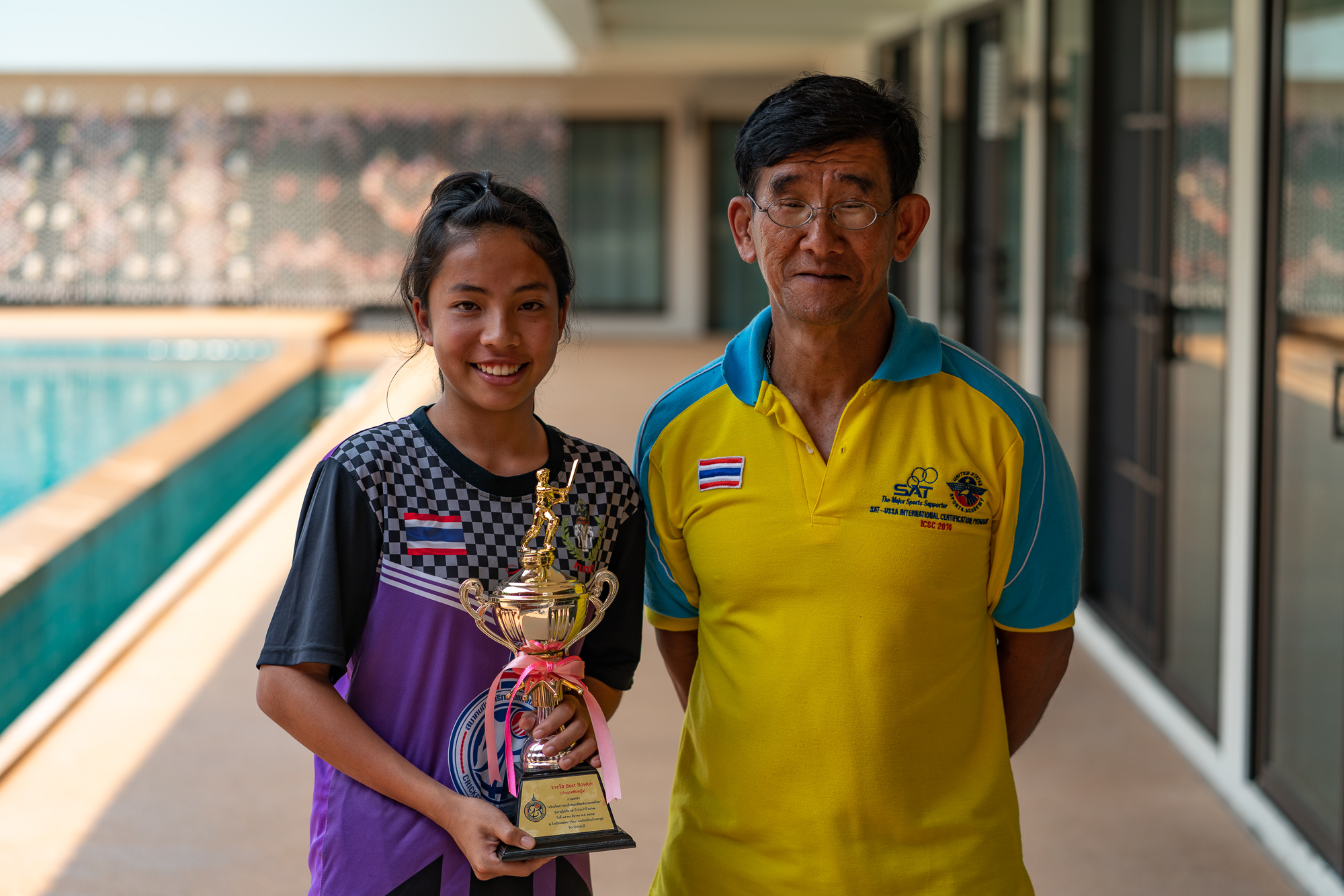 This young woman, pictured here with her coach, lives at our Doi Saket 1c home in Thailand, and is currently the best female bowler in her age group — in the world!
