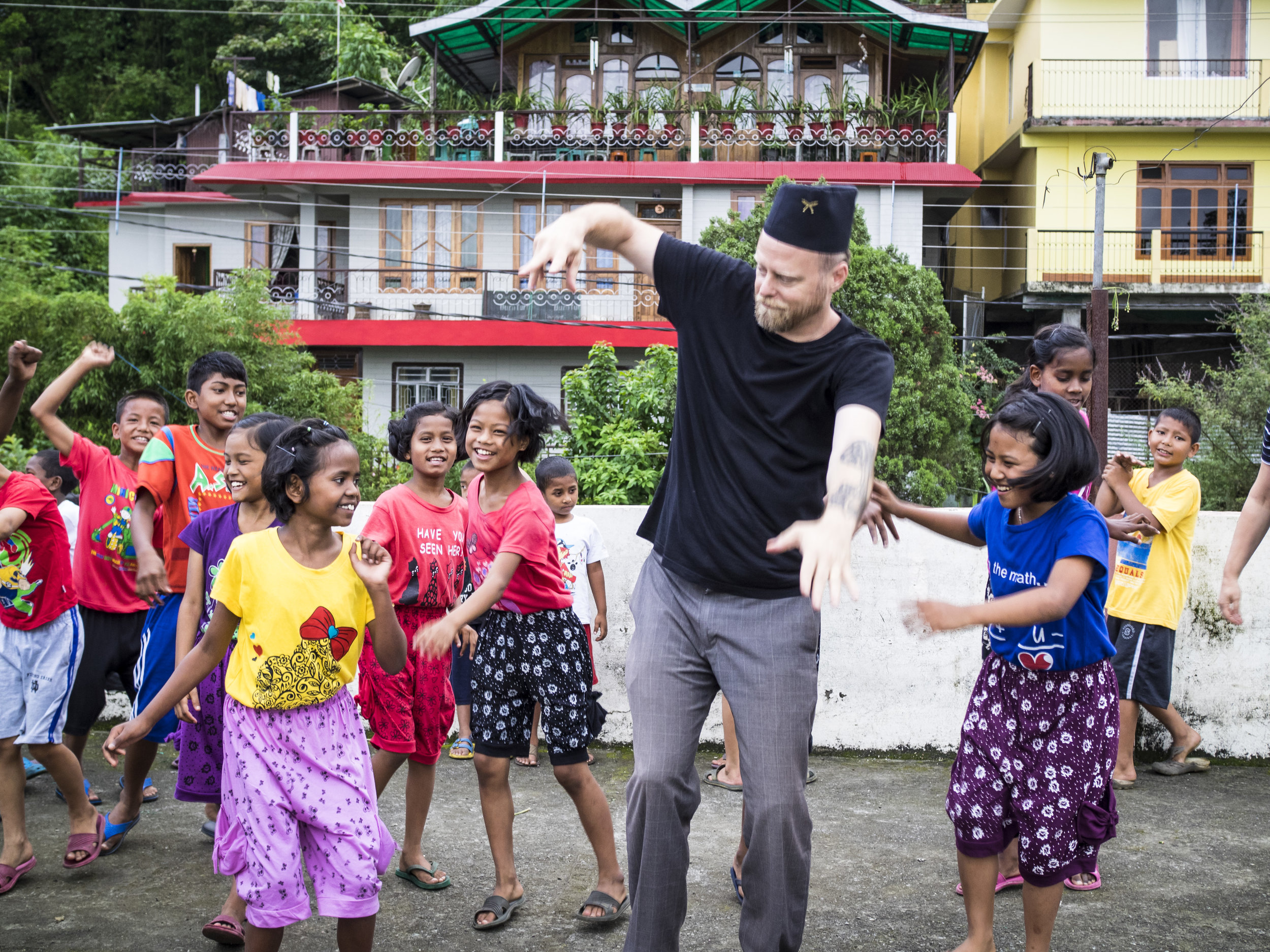 Executive Director John McCollum enjoys a dance break with the kids from our Kalimpong 2 home in India.