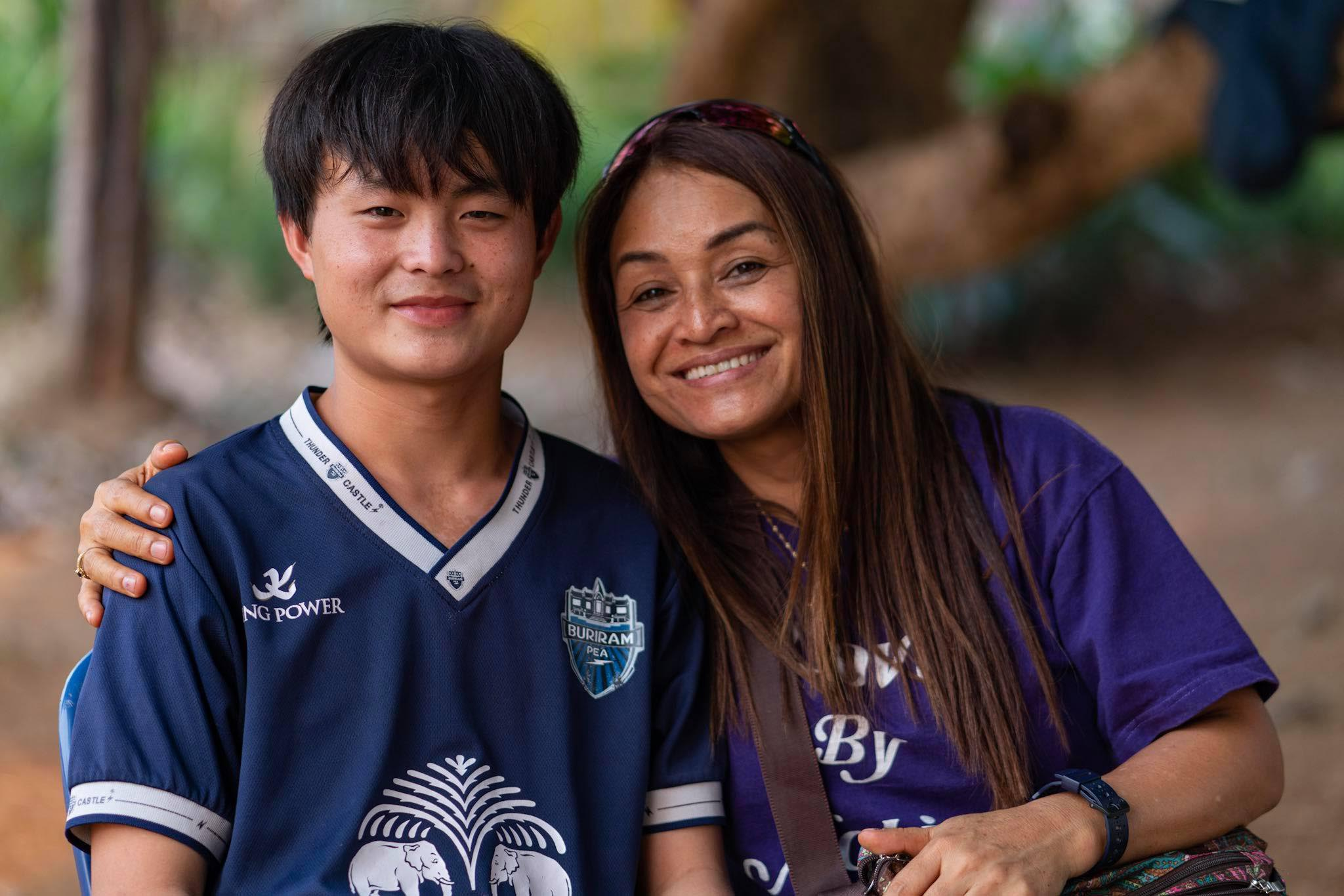 """Sixteen-year-old Jirayut, pictured here with our Thailand Director, Tutu """"Bee"""" Abourmad, is recovering miraculously from a life-threatening stroke thanks to your prayers and financial support."""
