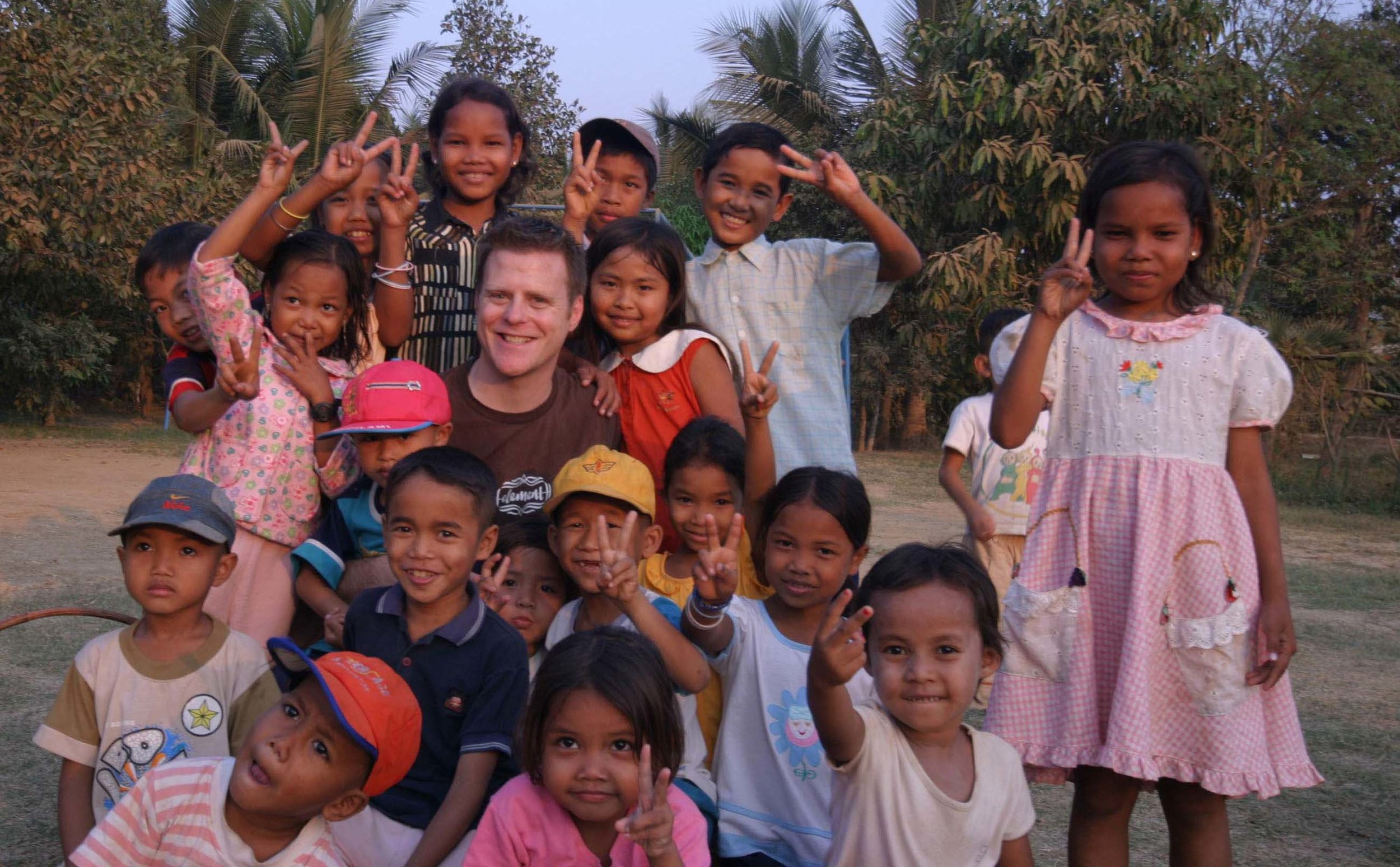 Me in February 2005, at our very first home in Battambang, Cambodia. Most — if not all — of these kids are now grown.