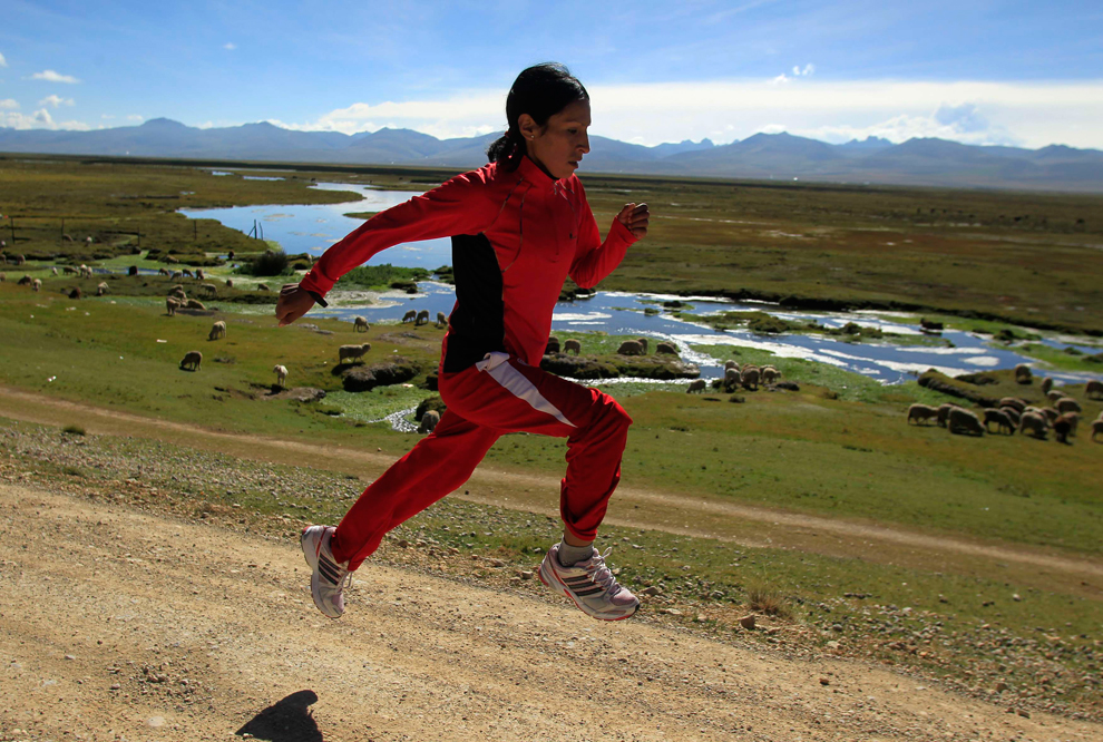"Marathon runner Gladys Tejeda, the first Peruvian athlete who qualified for the London Olympic Games, runs during her training in the Andean province of Junin on May 14. A private company will take Gladys' mother Marcelina Pucuhuaranga (69) to London as part of the ""Thank you Mom"" program. The program will take about 120 mothers of different athletes around the world to attend the games. Tejeda, the youngest of nine children, returned to her hometown to visit her mother and to focus on training where she will run more than 20 km every day in the highlands. (Pilar Olivares/Reuters)"