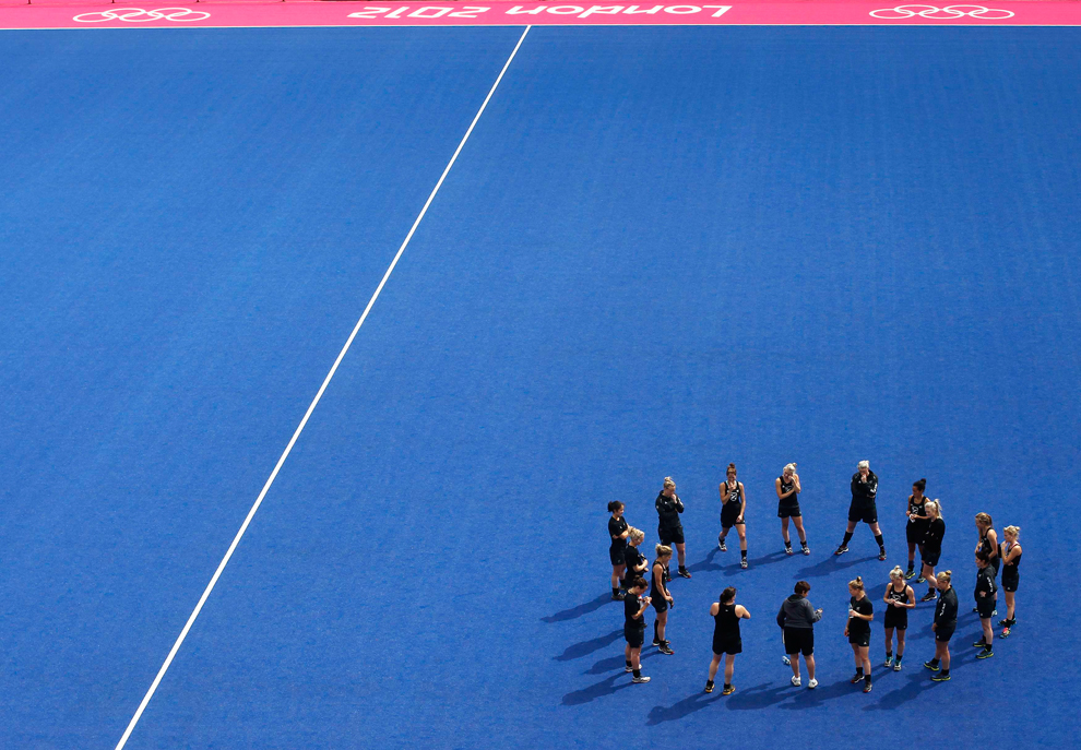 The New Zealand women's hockey team stretch after a training session at the Olympic Hockey venue, the Riverbank Arena, at the Olympic Park in Stratford, east London on July 17. The 2012 Olympic Games in London start on July 27. (Andrew Winning/Reuters)