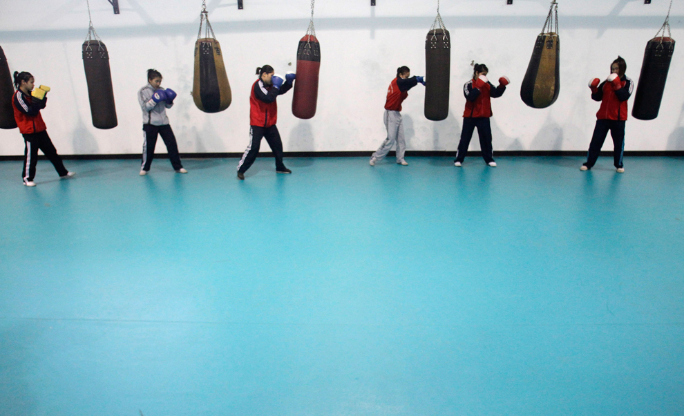 Members of the Vietnam female boxing team practise at a training center in Hanoi on Feb. 17. Vietnam plans to send it's boxers to North Korea for training in preparation for the London Olympics. (Kham/Reuters)
