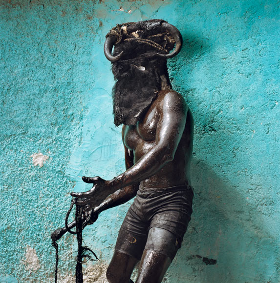 15-man-with-whip-haiti-cropped-670.jpg