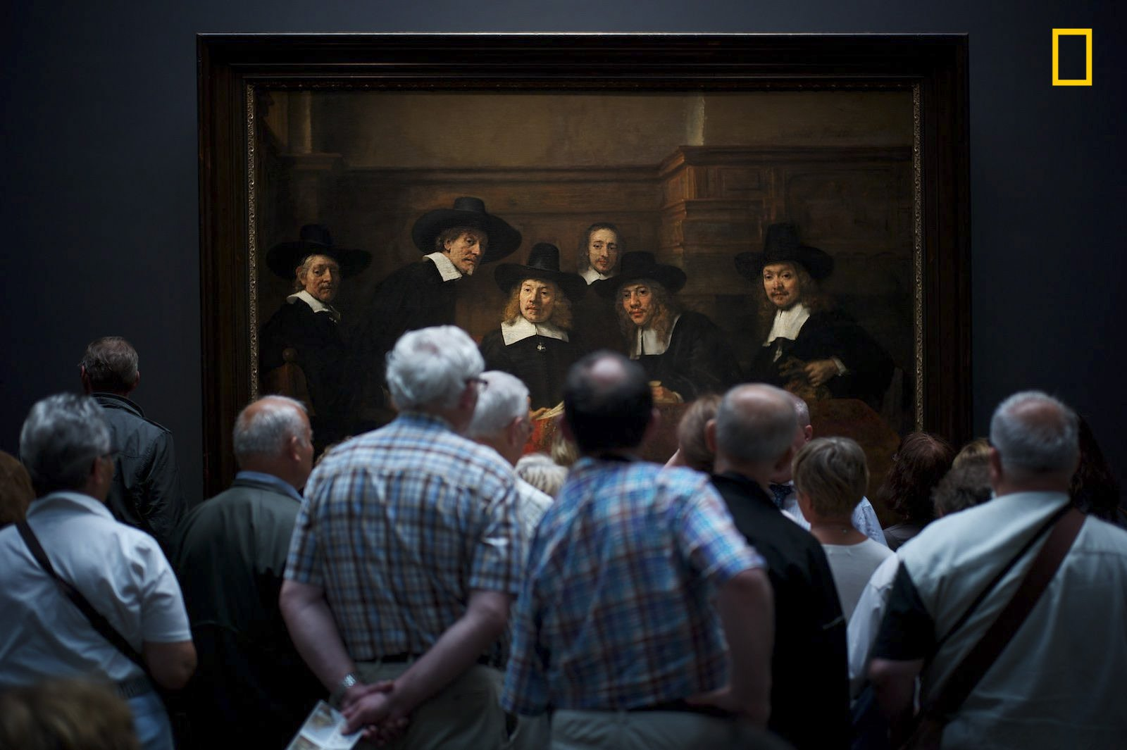 "PEOPLE - 2nd Place. Photo and caption by Julius Y./ National Geographic Travel Photographer of the Year.  Interesting moment . ""Museum visitors curiously watching Rembrandt's painting  'Syndics of the Drapers' Guild' where it gave the illusion that the people on the paintings too are curiously watching the visitors."""