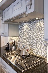 A tiled kitchen backsplash