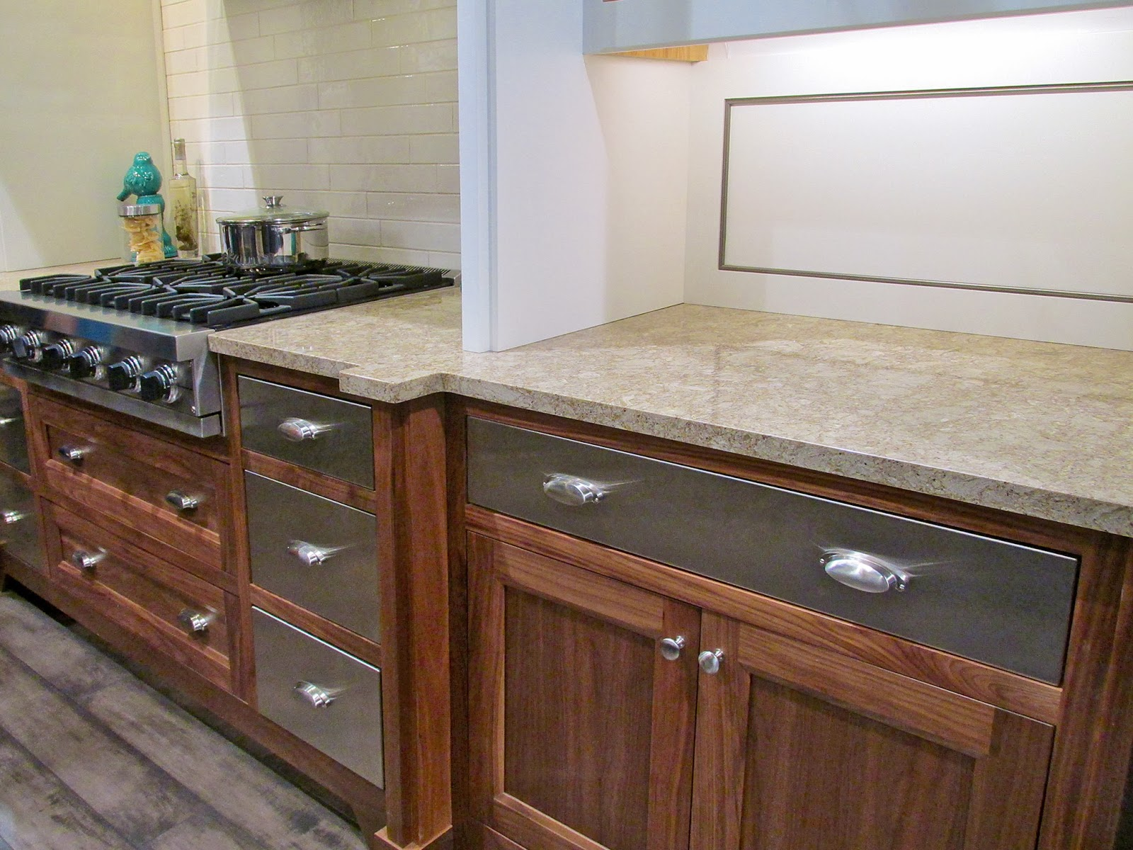 Smooth stainless drawers accentuate the wood grain. What a way to mix rustic and modern!