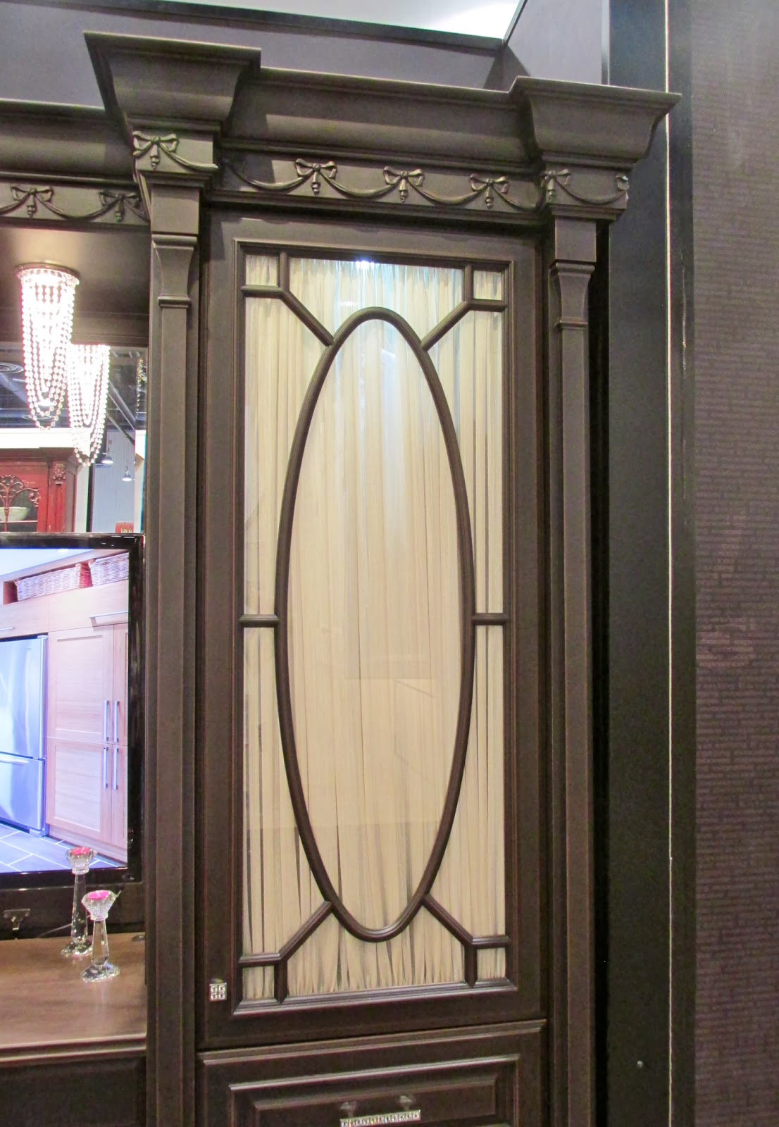 Another glass door. The grey-green color lends a modern feel to this traditional design.