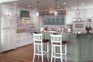 Here, the cool cabinet colors blend well with polished nickel hardware.