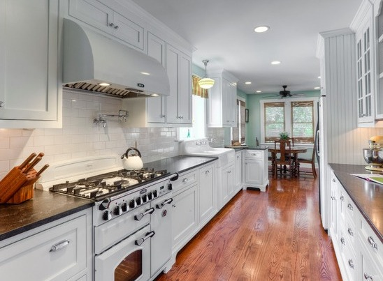 Look at this wonderful inset frame cabinetry in a galley kitchen by Elmwood FINE CUSTOM CABINETRY. Precise fit, beautifully finished and solidly constructed. We know you'll love it. Call OPEN DOOR BUILDING SOLUTIONS for more info about Elmwood Fine Custom Cabinetry.