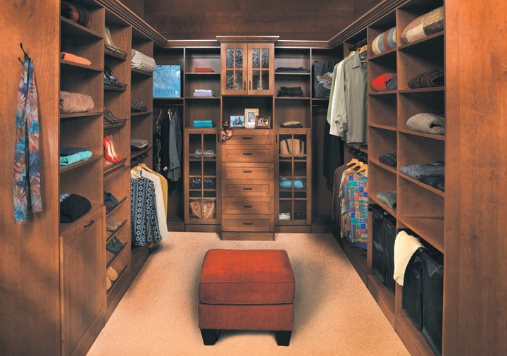 Jackson Door | Maple in Kona Finish.  This spacious, well-appointed closet features plenty of storage. The design of the hutch creates the feeling of a retail boutique at home, and makes favorite items easy to find.