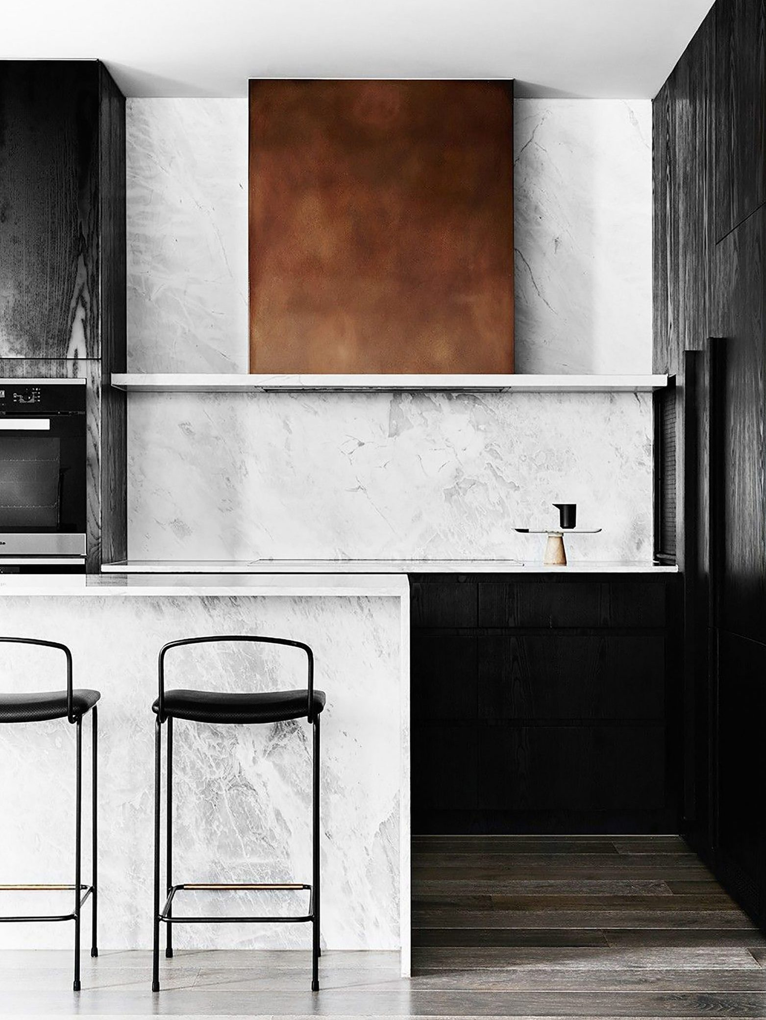 Clever storage solutions: induction cooktops, integrated refrigerators, stoves, microwaves and — most important — range hoods that don't look anything like they use to! Note the copper-y finish on the range hood. Slick!!