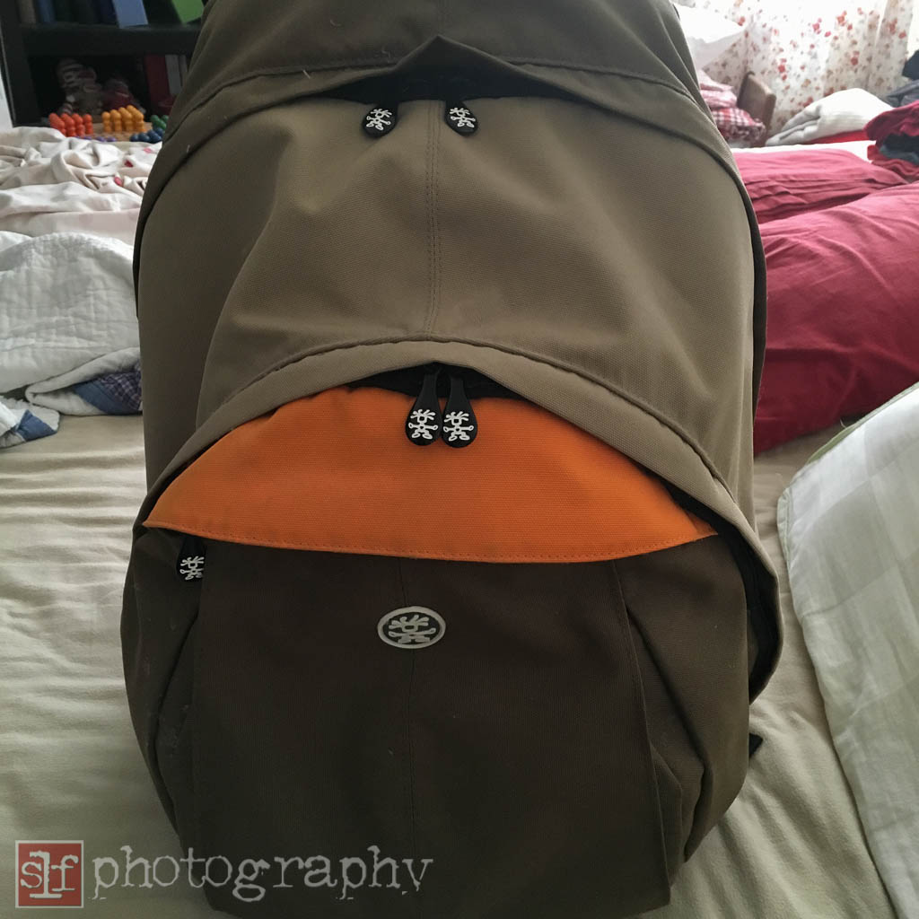 I took my Crumpler backpack. It is more padded and has some channels to allow airflow against my back. However, it is heavy.