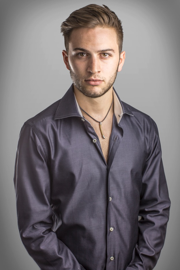 Studio portrait. Shot with two lights and a white paper background.