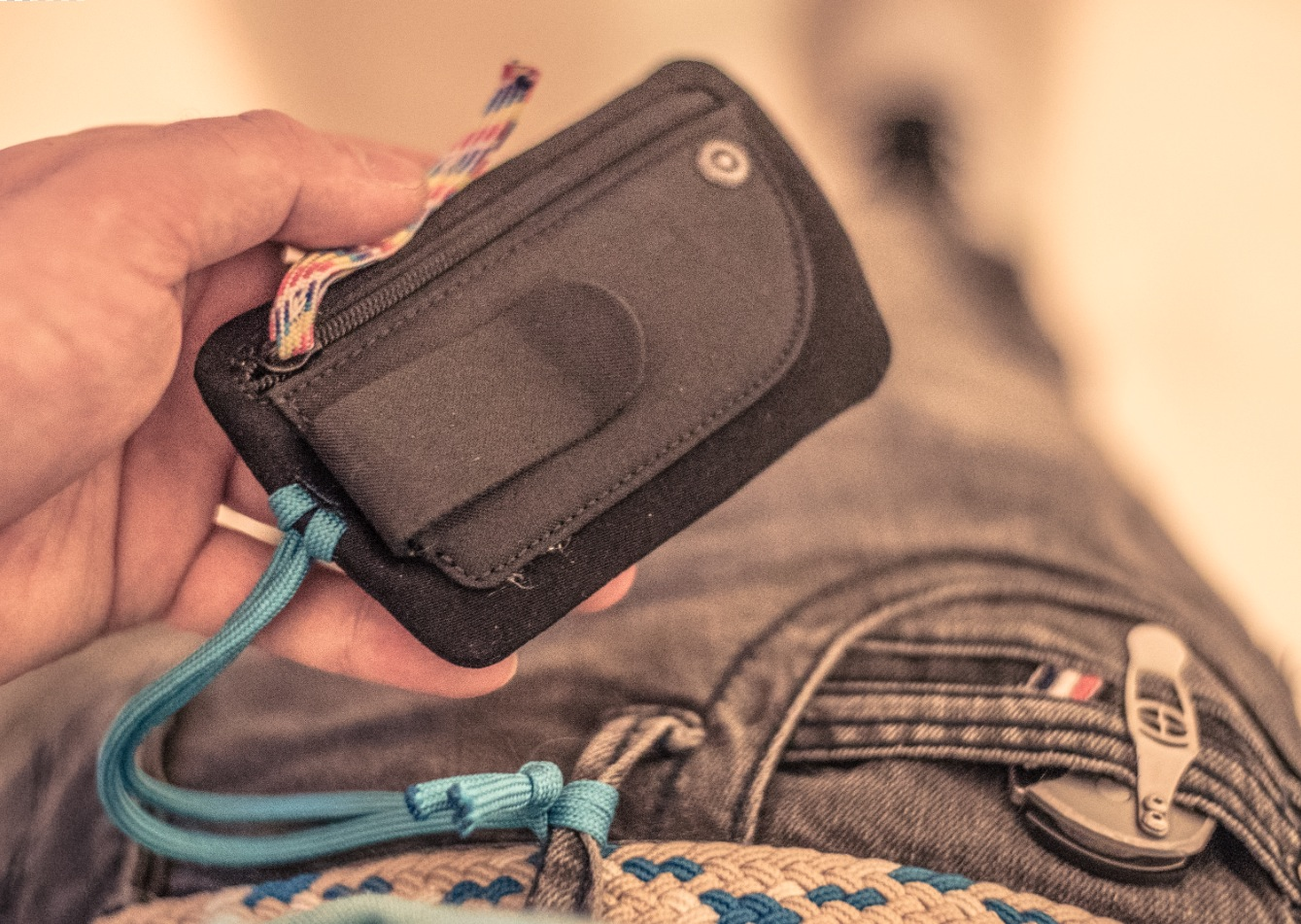 """The  Go 887 travel wallet . I added a couple of strings, one for securing to my belt loop and another as a replacement to the metal zip pull-tab thing. And I removed the """"Go"""" logo tag."""