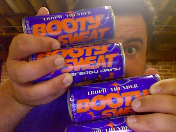 Ryan Davis holding up the Booty Sweat I sent to the Whiskey Media office.