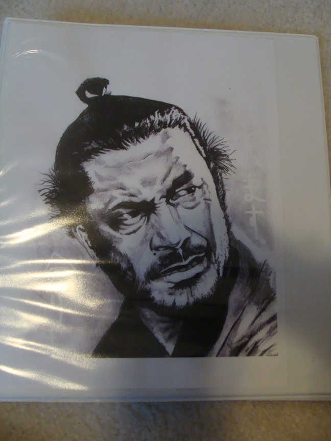 My brother's binder for our trip to Japan. A badass drawing of Toshiro Mifune.