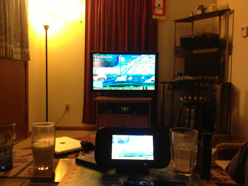 Playing New Super Mario Bros. U with my mom and brother.