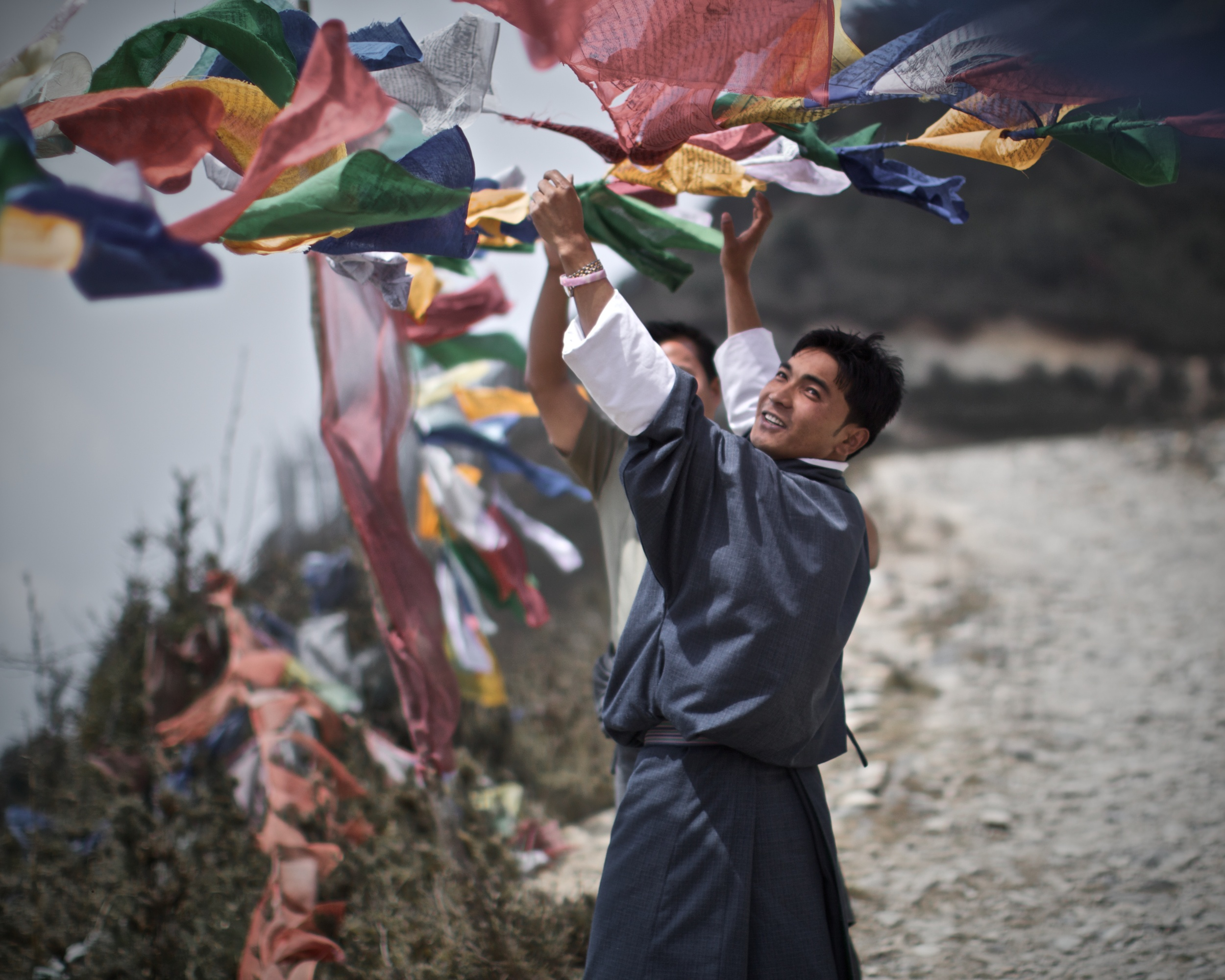 Hanging prayer flags in a windy place.jpg