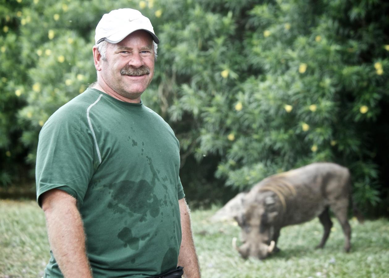 Leo and a wart hog