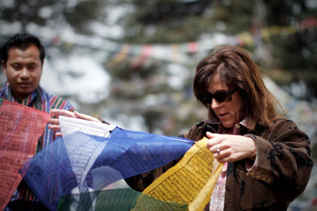 Patty hanging her prayer flags.