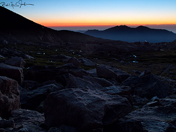 4:34 AM: About a quarter mile from Chasm Lake, looking east, and back from whence we came, towards sunrise.
