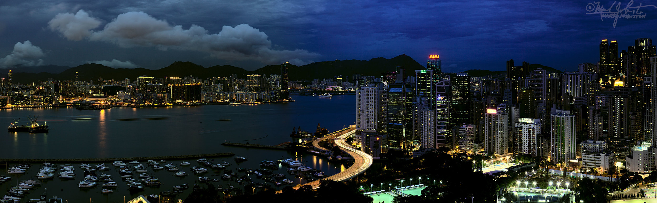 Hong Kong, and across Victoria Harbor, Kowloon, from the Causeway Bay area.
