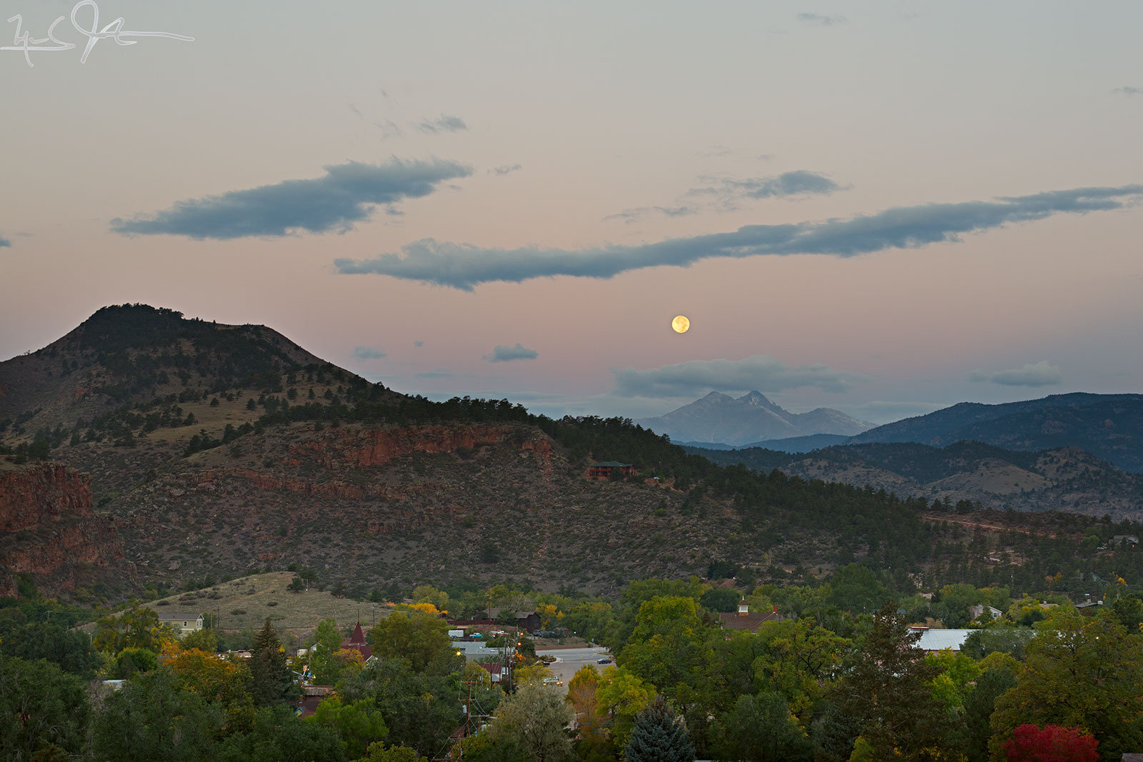 6:47 AM:  The Harvest Moon slides down and right [North] towards the summits of Mt. Meeker and Long's Peak, over the town of Lyons, Colorado.