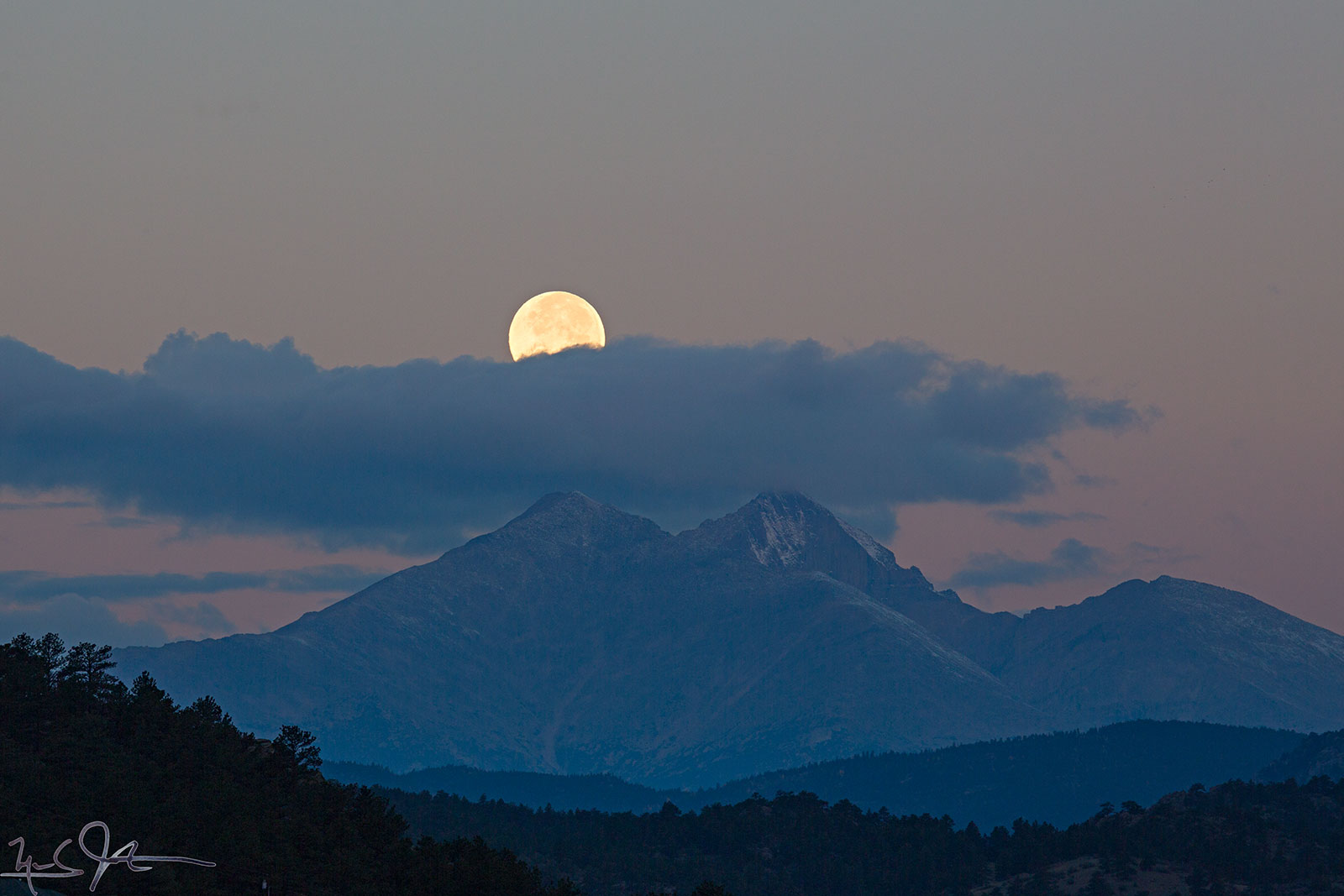 6:53 AM:  Last glimpse of the Harvest Moon before it is hidden behind a cloud bank hovering over Mt. Meeker and Long's Peak.  Official moonset didn't occur until 40 minutes later at 7:31 AM.