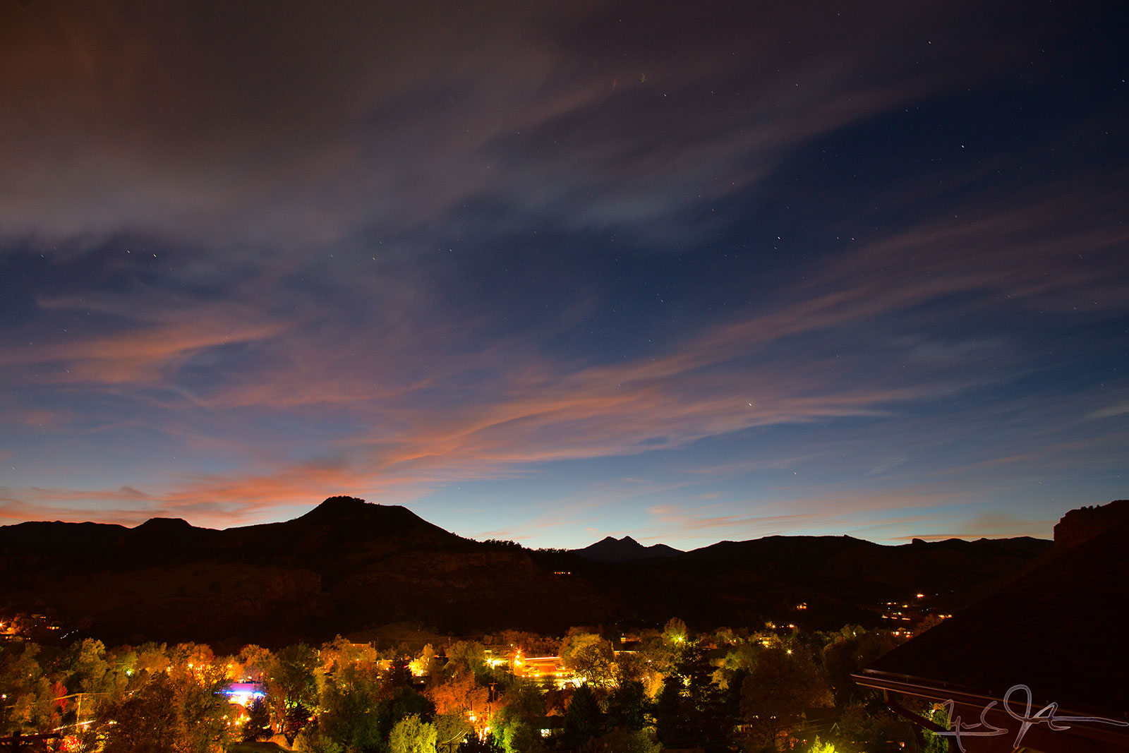 City lights come up and the stars come out as sunset fades over Lyons.