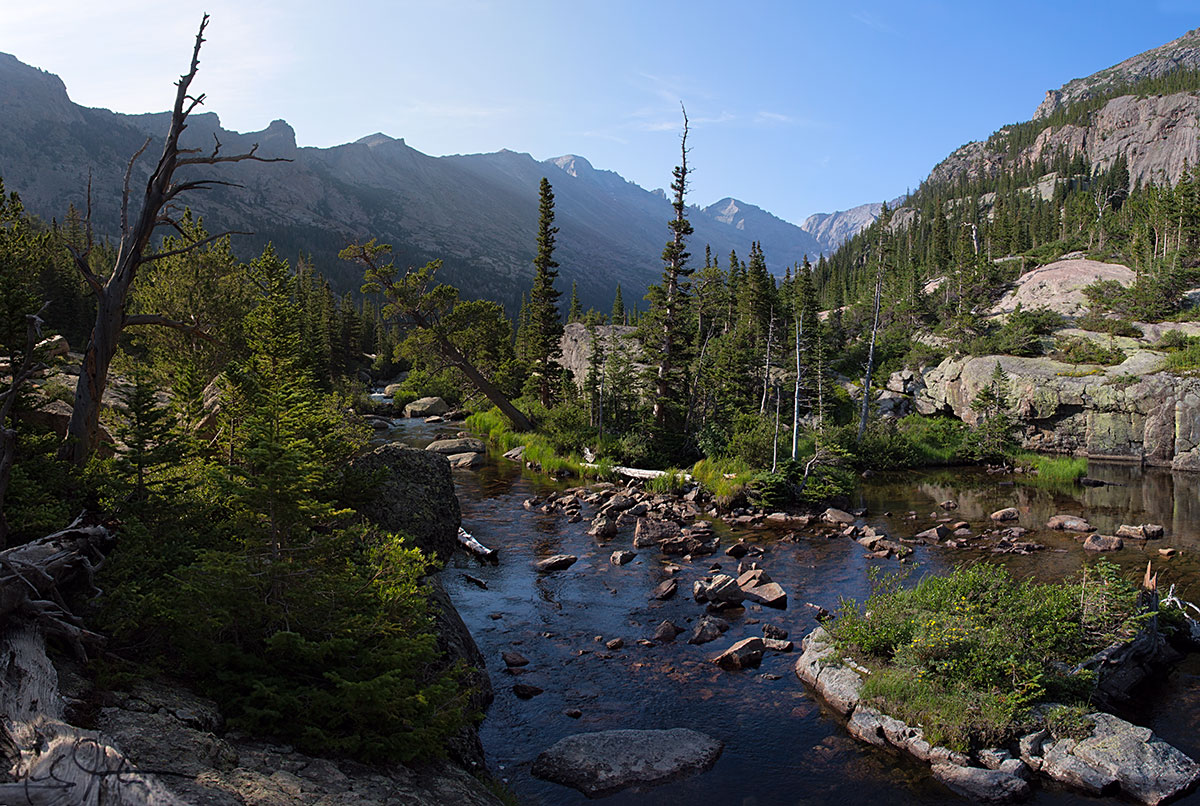 The approach to Mills Lake in Glacier Gorge, Rocky Mountain National Park. Long's Peak is the squarish dome on the horizon at center, and beyond, Keyboard of the Winds and Pagoda Mountain.