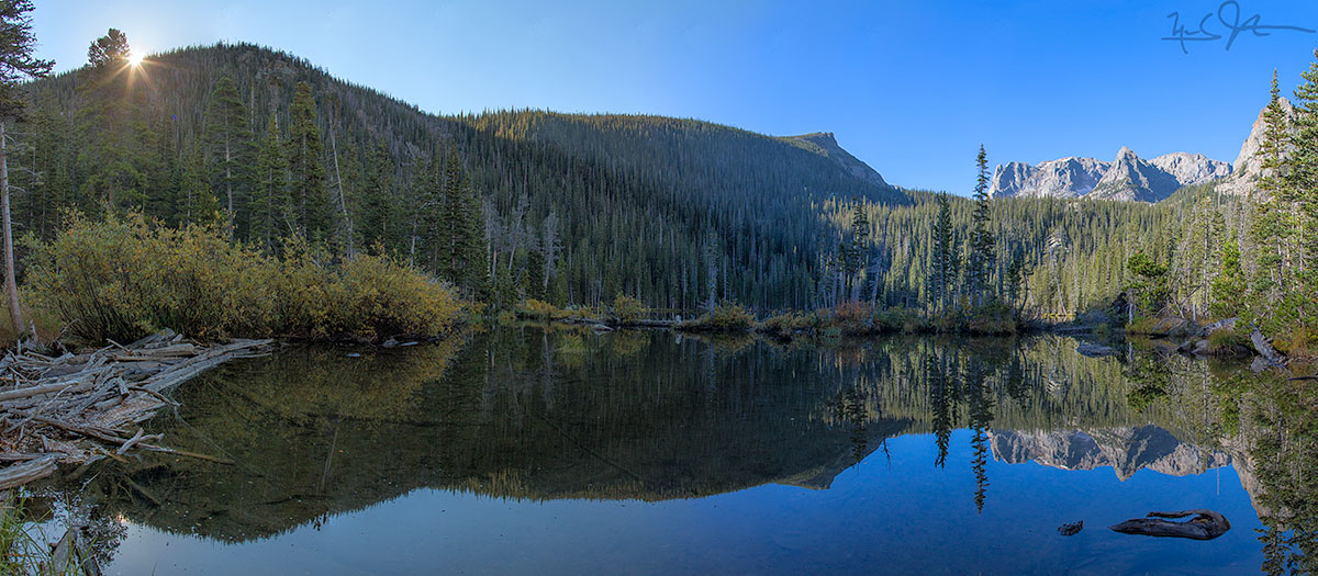 Fern Lake. Odessa Lake lies just beneath Notchtop Mountain and the Little Matterhorn, both in the distance at right.