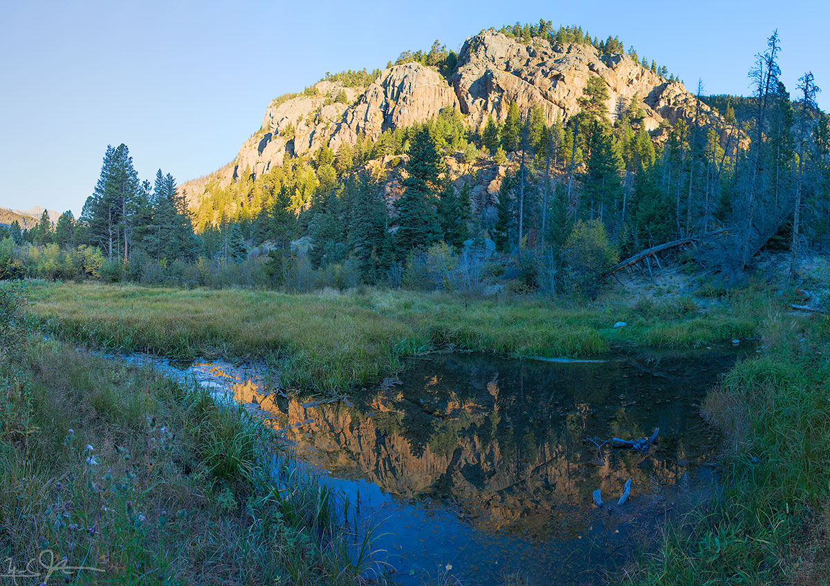 Morning sunlight on the canyon walls above the Fern Lake trail.
