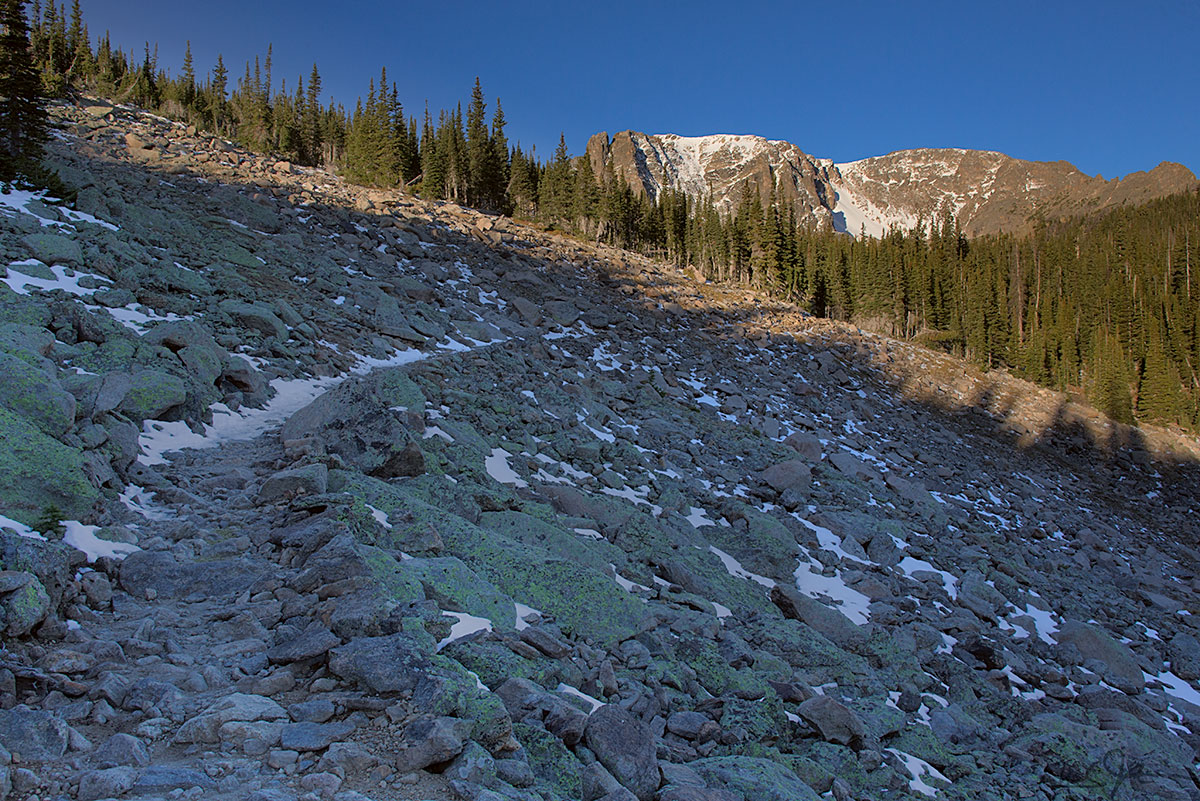 A first glimpse of Notchtop Mountain from the trail as it crosses a talus slope at around 10,500 feet.