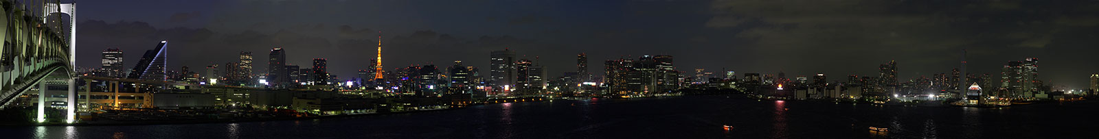 A panoramic view of Tokyo Harbor from one of the pedestrian parapets on Rainbow Bridge. Click on the image to expand. Enlarge your browser window for more detail.
