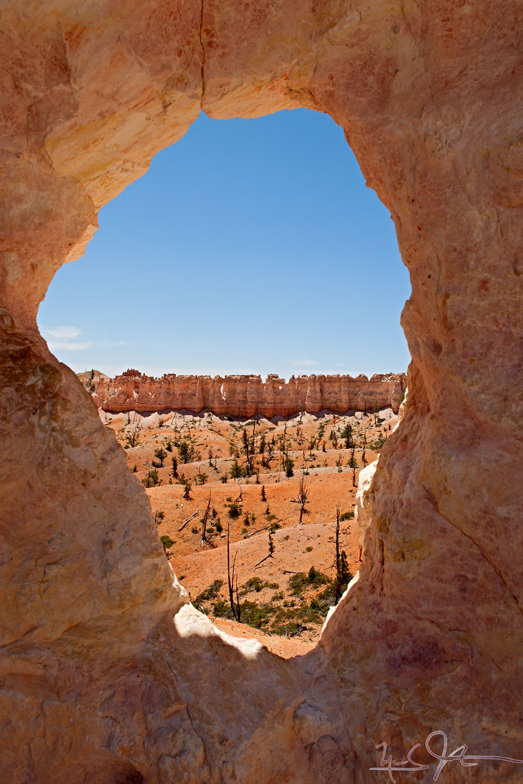 A window in the rock provides a view - Fairyland Loop trail in Bryce Canyon National Park, Utah.