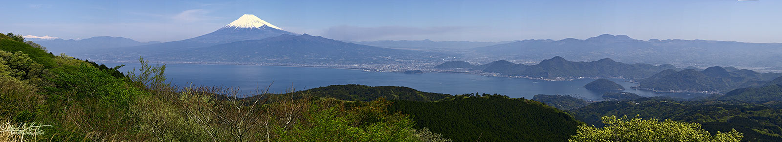 Mt. Fuji and the city of Numazu from the spine of Japan's Izu Penninsula, Shizuoka Prefecture.