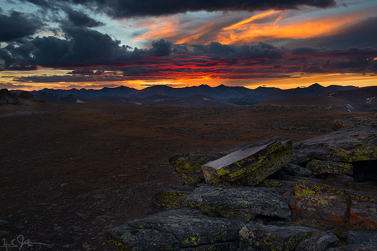 The sun sets behind the Never Summer Mountains from a vantage point in Rocky Mountain National Park.