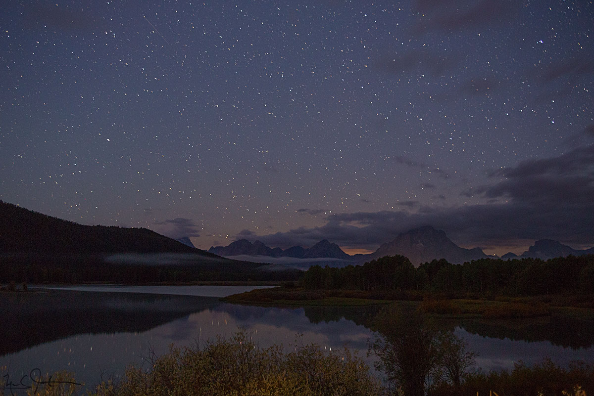 Pre-dawn stars over Oxbow Bend and the Grand Teton Mountains.