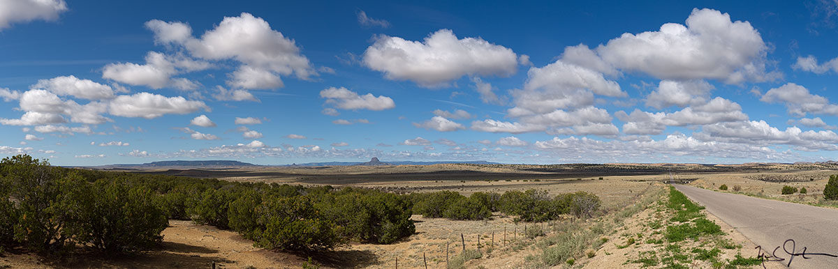 Panorama with Cabezon Peak on the horizon at center, near San Ysidro, New Mexico.
