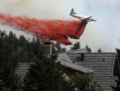 """A heavy tanker drops fire  retardant while fighting the  Flagstaff wildfire on Tuesday, June 26, in  Boulder.""""  (Jeremy Papasso /  Daily Camera)"""