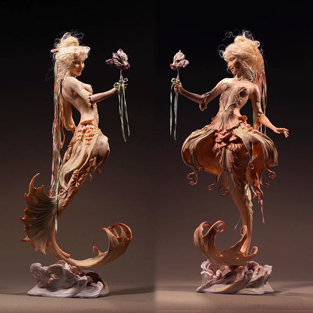 "A Fish from Versailles, my first one from a few years back, two views. She's quite petite, perhaps an 8"" figure or so. Kato Polyclay with mohair. (Sorry to be scarce! I shall return — just super pressed at the moment! But there will be much new to show soon.  Thanks for sticking with me!) — #mermaid #katopolyclay #versailles #artdoll #forestrogers #fantasyart #polymerclay #sculpt #rococo #decorativeart"