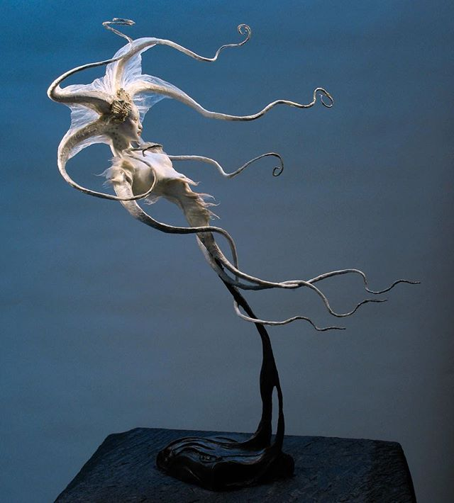 Octopoid Drifting, in Japanese air-dry clay with Aves epoxy clay and mulberry paper, over stainless steel & aluminum wire armature. Sorry to be absent so much! I shall return — challenging transitions in my world at the moment. — #octopus #octopoid #octonation #forestrogers #imaginativerealism #fantasyart #surrealism #popsurrealism