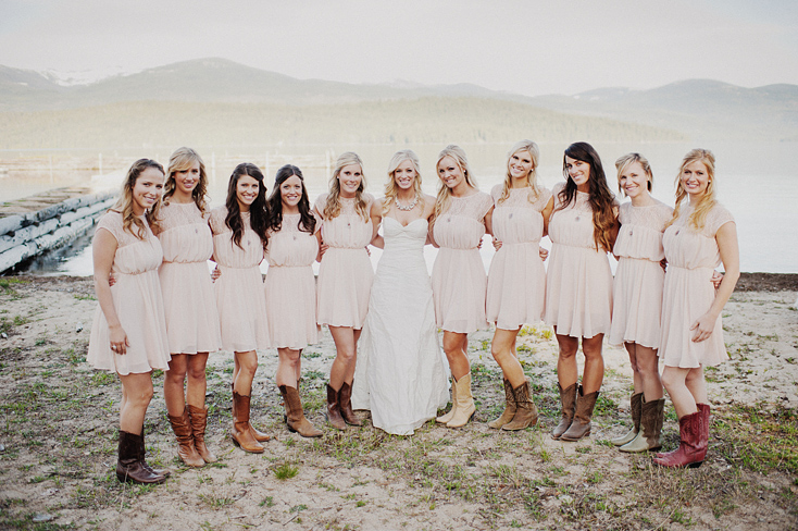 Blush bridesmaids dresses and cowboy boots in Priest Lake, Idaho, by Ryan Flynn Photography.