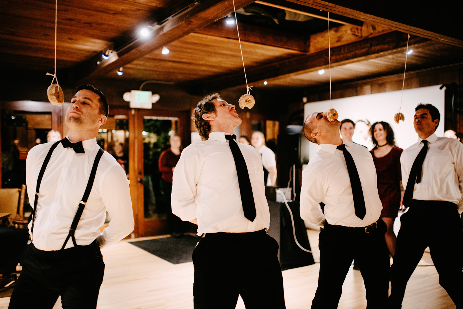 050-hilarious-wedding-game-of-donut-eating-contest-at-kiana-lodge.jpg