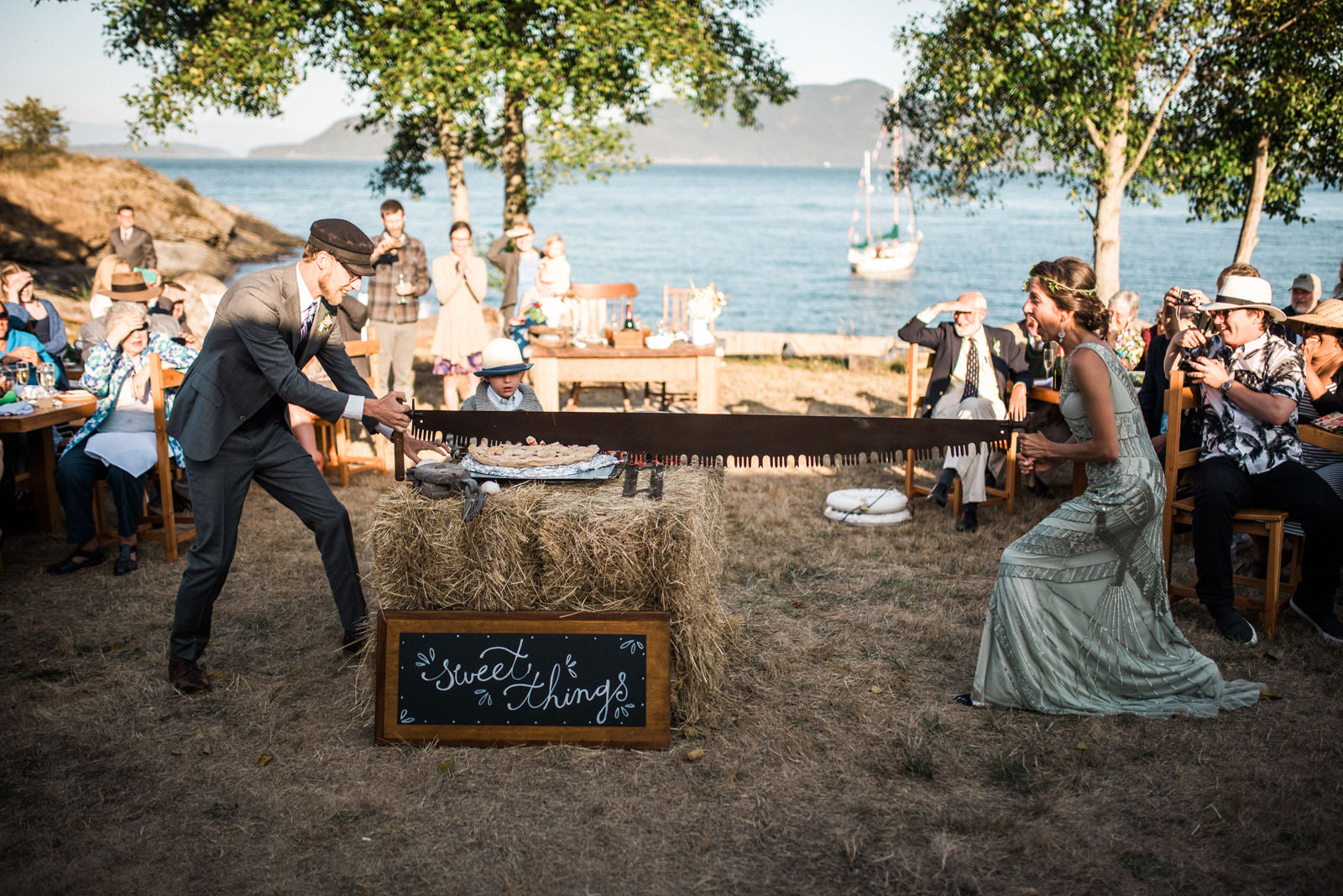 075-bride-and-groom-using-band-saw-to-cut-wedding-pie-by-orcas-island-wedding-photographer.jpg