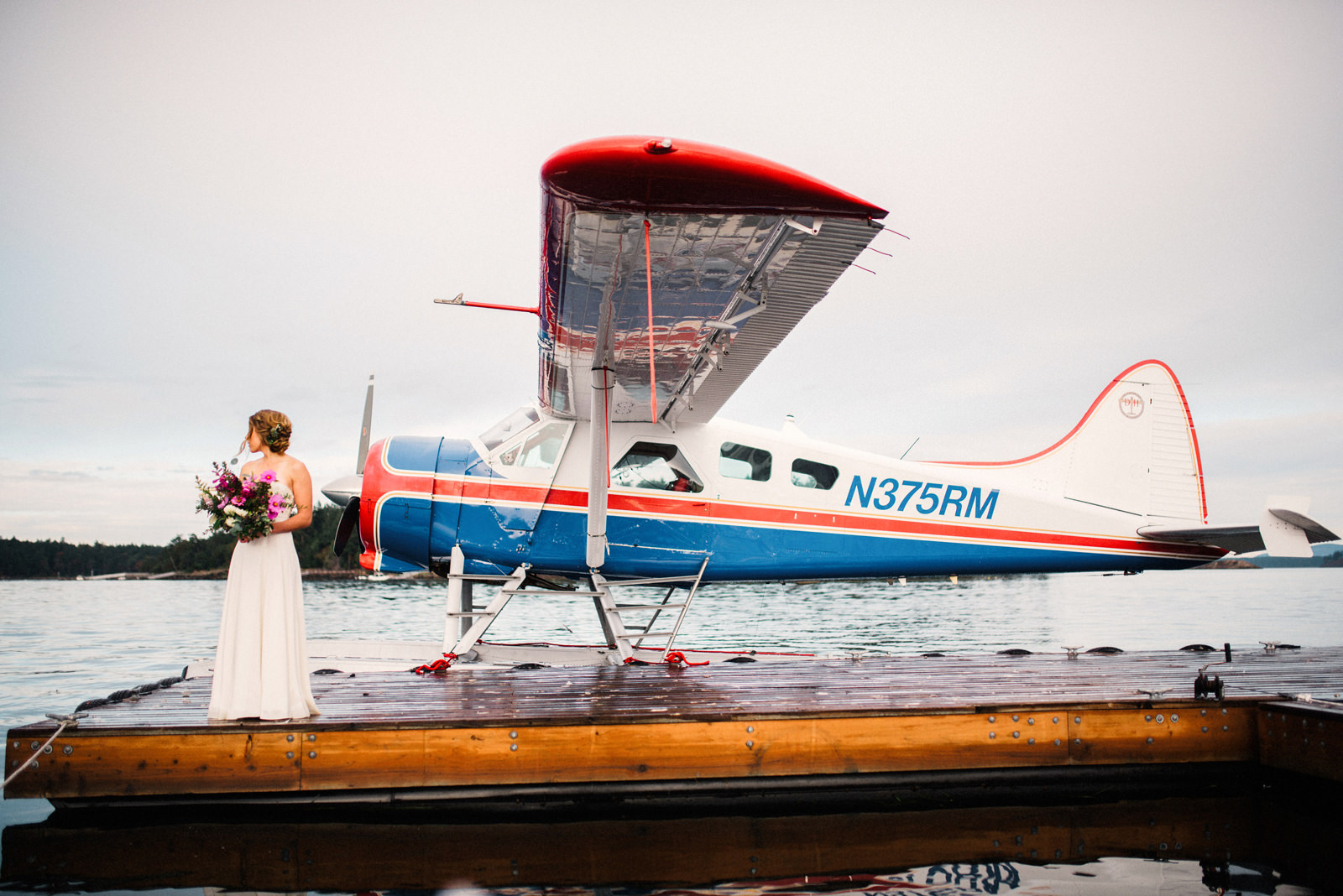 085-roche-harbor-wedding-with-bride-and-seaplane-in-the-san-juan-islands.jpg